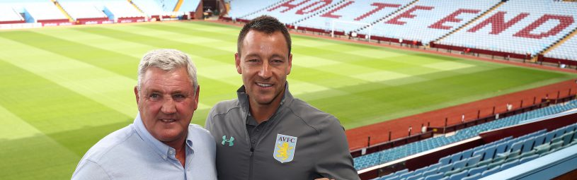 New Aston Villa signing John Terry with manager Steve Bruce during the press conference at Villa Park, Birmingham.