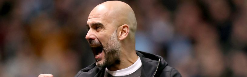 Manchester City manager Pep Guardiola celebrates as Leroy Sane scores the first goal of the game
