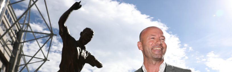Alan Shearer poses for a photograph next to the newly unveiled statue of himself outside St James' Park, Newcastle.